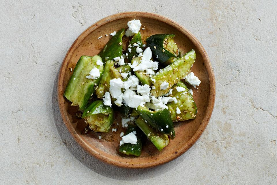 "When you're working with just a few ingredients, you've got to do them up right. In this summer salad recipe, that means smashing the cukes so they'll absorb more flavor, and toasting the garlic in oil until it's nutty and fragrant. <a href=""https://www.epicurious.com/recipes/food/views/smashed-cucumber-salad-with-zaatar-and-feta?mbid=synd_yahoo_rss"" rel=""nofollow noopener"" target=""_blank"" data-ylk=""slk:See recipe."" class=""link rapid-noclick-resp"">See recipe.</a>"