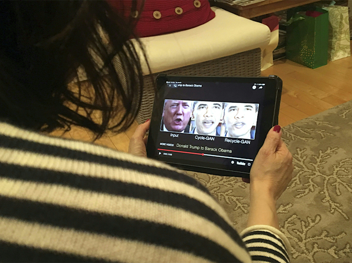 "A woman in Washington, DC, views a manipulated video on January 24, 2019, that changes what is said by President Donald Trump and former president Barack Obama, illustrating how deepfake technology can deceive viewers. - ""Deepfake"" videos that manipulate reality are becoming more sophisticated and realistic as a result of advances in artificial intelligence, creating a potential for new kinds of misinformation with devastating consequences: Credit: ROB LEVER/AFP via Getty Images"