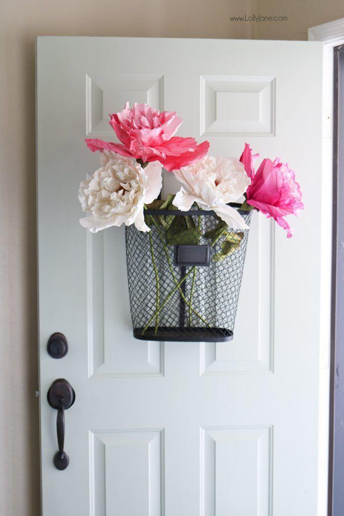 """<p>How's this for a twist on an Easter wreath? Here, you'll use a black wire basket that's filled with giant paper flowers to achieve an inviting look.</p><p><strong>Get the tutorial at <a href=""""https://lollyjane.com/easy-spring-porch-refresh-door-makeover/"""" rel=""""nofollow noopener"""" target=""""_blank"""" data-ylk=""""slk:Lolly Jane"""" class=""""link rapid-noclick-resp"""">Lolly Jane</a>.</strong></p><p><a class=""""link rapid-noclick-resp"""" href=""""https://go.redirectingat.com?id=74968X1596630&url=https%3A%2F%2Fwww.walmart.com%2Fip%2F24-Pink-and-Green-Decorative-Spring-Floral-Artificial-Craft-Stem%2F386654634&sref=https%3A%2F%2Fwww.thepioneerwoman.com%2Fhome-lifestyle%2Fcrafts-diy%2Fg35698457%2Fdiy-easter-wreath-ideas%2F"""" rel=""""nofollow noopener"""" target=""""_blank"""" data-ylk=""""slk:SHOP PAPER FLOWERS"""">SHOP PAPER FLOWERS</a></p>"""