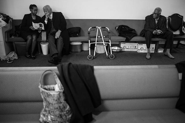 <p>Spencer Leak Sr speaks to one of his employees at a funeral at New Bethleham Church on Chicago's south side. (Photo: Jon Lowenstein/NOOR for Yahoo News) </p>