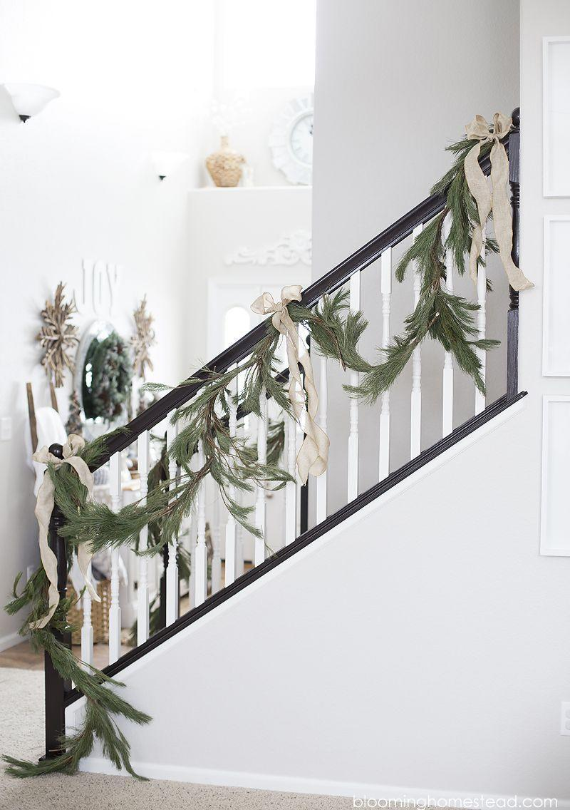 """<p>Here's an example of less is more! Live pine roping with simple bows offer understated elegance.</p><p><strong>See more at <a href=""""https://www.bloominghomestead.com/2016/12/christmas-home-tour-2016.html"""" rel=""""nofollow noopener"""" target=""""_blank"""" data-ylk=""""slk:Blooming Homestead."""" class=""""link rapid-noclick-resp"""">Blooming Homestead.</a></strong></p><p><a class=""""link rapid-noclick-resp"""" href=""""https://www.amazon.com/Morex-Ribbon-B00A23K26W-Inch-Yards/dp/B00A23K26W/ref=sr_1_40?dchild=1&keywords=christmas+wired+ribbon&qid=1633170580&sr=8-40&tag=syn-yahoo-20&ascsubtag=%5Bartid%7C2164.g.37723896%5Bsrc%7Cyahoo-us"""" rel=""""nofollow noopener"""" target=""""_blank"""" data-ylk=""""slk:SHOP WIRED RIBBON"""">SHOP WIRED RIBBON</a></p>"""