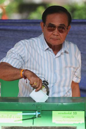 Thailand's Prime Minister Prayuth Chan-ocha casts his ballot to vote in the general election at a polling station in Bangkok, Thailand, March 24, 2019. REUTERS/Athit Perawongmetha