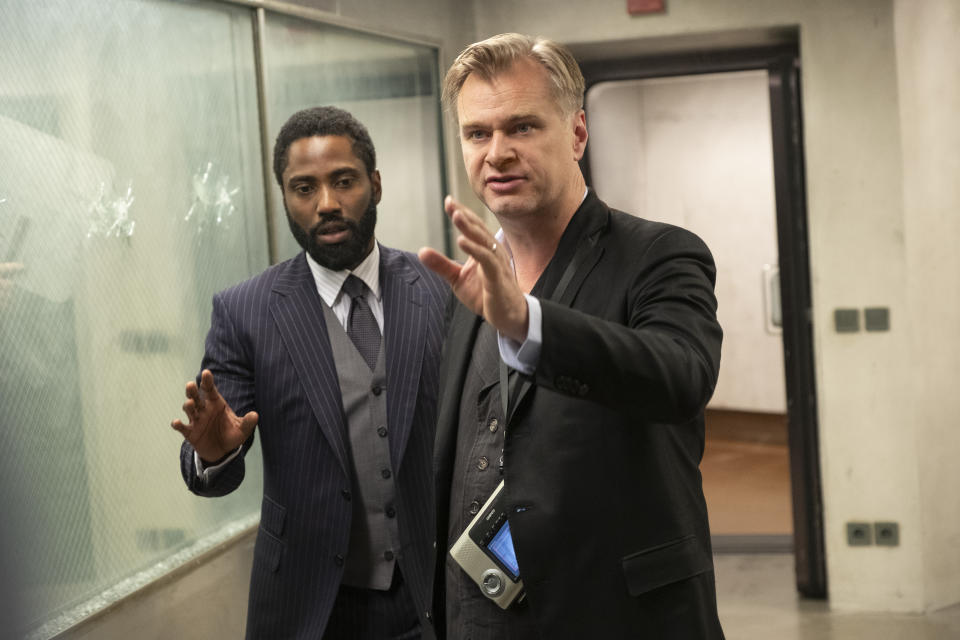 "(L-r) JOHN DAVID WASHINGTON and director/writer/producer CHRISTOPHER NOLAN on the set of Warner Bros. Pictures' action epic ""TENET,"" a Warner Bros. Pictures release.  (Warner Bros.)"