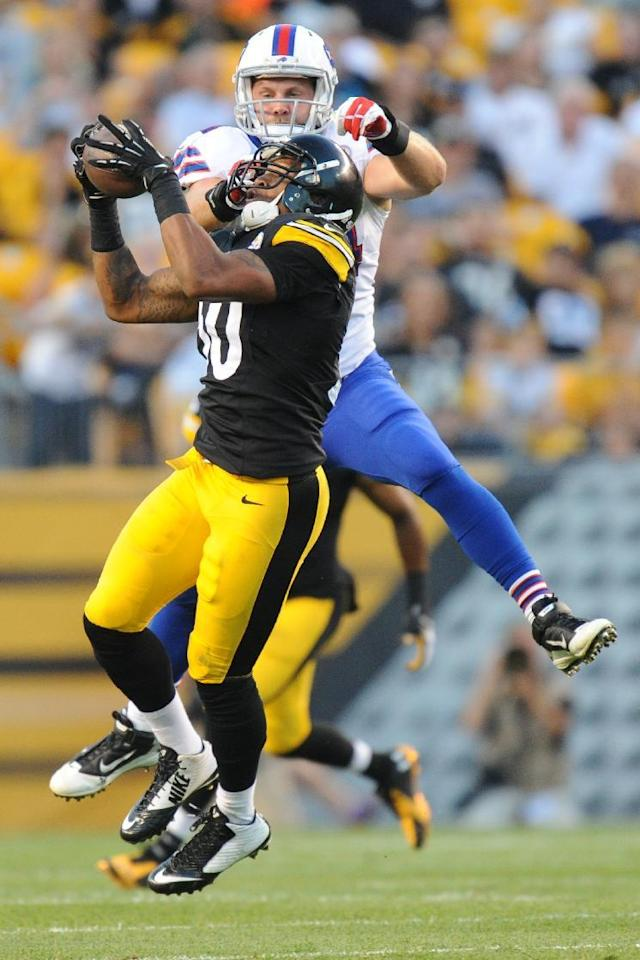 Pittsburgh Steelers outside linebacker Ryan Shazier (50) intercepts a pass intended for Buffalo Bills tight end Scott Chandler (84) in the first quarter of an NFL football preseason game on Saturday, Aug. 16, 2014, in Pittsburgh. (AP Photo/Don Wright)