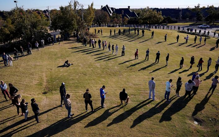 Voters wait in a long line to cast their ballots at Church of the Servant in Oklahoma City - NICK OXFORD /REUTERS