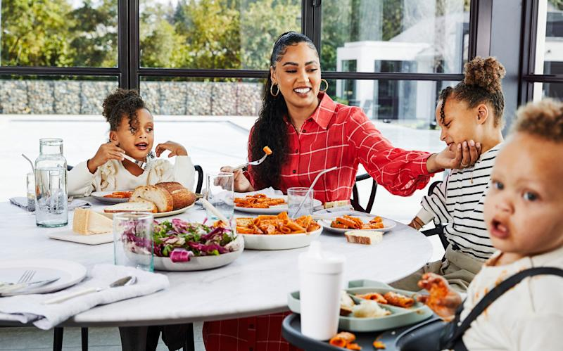 Ayesha Curry enjoys a meal with her children: Ryan, far left, Riley and Canon.