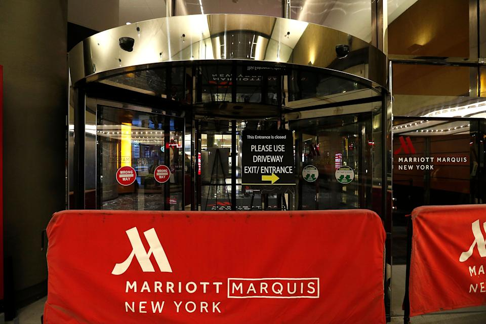 The entrance to Hotel Marriott and the Marquis Theatre, which is closed to the public due to the coronavirus, is seen on March 17 in New York City. The tourism and entertainment industries have been hit hard by the restrictions in response to the outbreak of COVID-19. (Photo: John Lamparski via Getty Images)