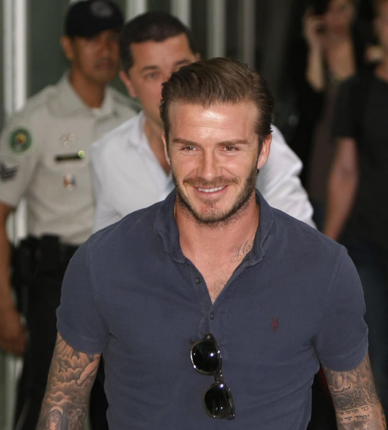 British soccer player David Beckham of the Los Angeles Galaxy smiles upon arrival at the Ninoy Aquino International Airport at suburban Pasay city south of Manila, Philippines Thursday Dec.1, 2011. Beckham and the LA Galaxy team are here for a friendly soccer match with the Philippine team known as the Azkals. (AP  Photo/Bullit Marquez)