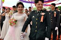 Same-sex couple Chen Ying-hsuan (R) and Li Li-chen take part in a mass wedding hosted by the Taiwanese military