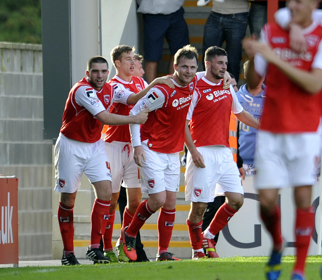 Morecambe's Padraig Amond (Third left) celebrates after he scores the fourth goal of the game for his side during the Sky Bet League Two match at Globe Arena, Morecambe.