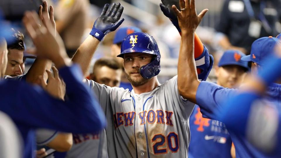 Sep 7, 2021; Miami, Florida, USA; New York Mets first baseman Pete Alonso (20) celebrates with teammates after hitting a home run during the ninth inning against the Miami Marlins at loanDepot Park.