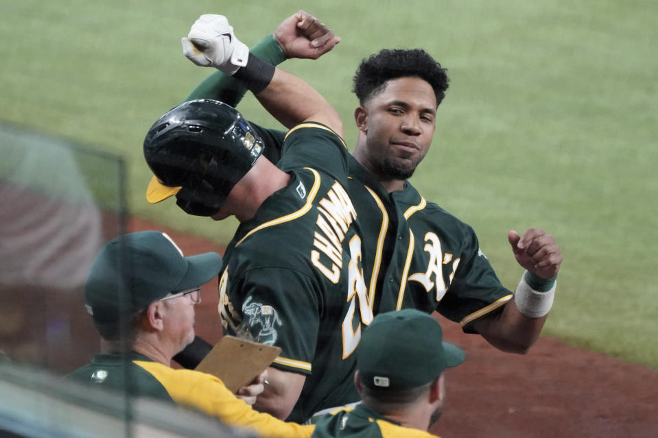 Oakland Athletics' Elvis Andrus congratulates Matt Chapman (26) after his first-inning home run against the Texas Rangers in the first inning of a baseball game Tuesday, June 22, 2021, in Arlington, Texas. (AP Photo/Louis DeLuca)