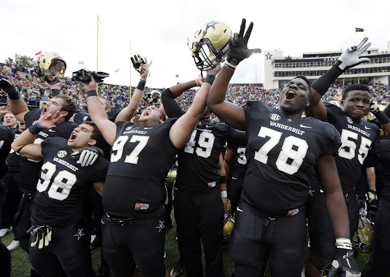 Vanderbilt players celebrate after upsetting No. 15 Georgia 31-27 in an NCAA college football game on Saturday, Oct. 19, 2013, in Nashville, Tenn. (AP Photo/Mark Humphrey)