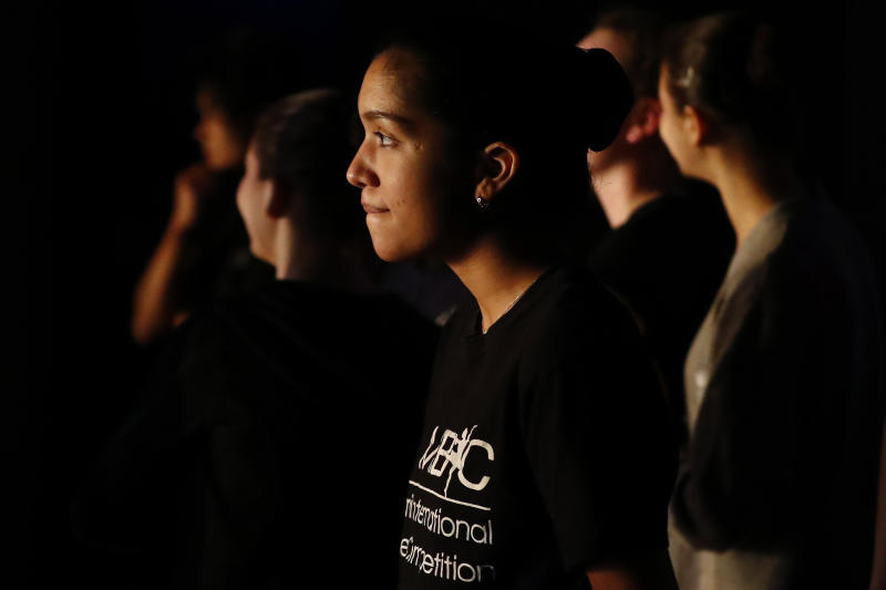 """Paola Nava, 17, watches backstage during a rehearsal of Vladimir Issaev's rendition of The Nutcracker ballet on Friday, Dec. 13, 2019, in Fort Lauderdale, Fla. More than 20 dancers of Venezuelan origin were playing various roles on a recent performance of the holiday favorite """"The Nutcracker."""" Some of these dancers are here seeking asylum after fleeing their crisis-torn nation, which is plagued by shortages of food and medicine. (AP Photo/Brynn Anderson)"""