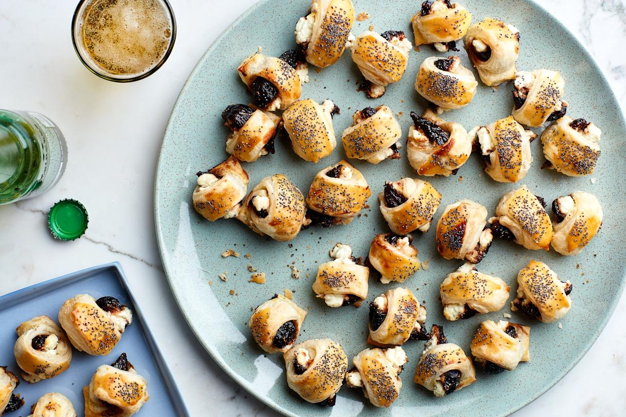 "Spicy, honey-glazed figs and creamy goat cheese are baked in puff pastry in this fun vegetarian play on pigs-in-a-blanket. <a href=""https://www.epicurious.com/recipes/food/views/figs-in-a-blanket-with-goat-cheese?mbid=synd_yahoo_rss"">See recipe.</a>"