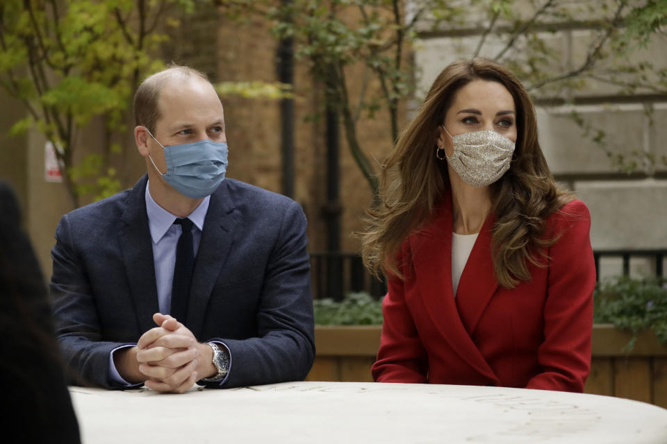 LONDON, ENGLAND - OCTOBER 20: Prince William and Catherine, Duchess of Cambridge meet pharmacist Joyce Duah as they visit St. Bartholomew's Hospital in London, to mark the launch of the nationwide 'Hold Still' community photography project, on October 20th, 2020 in London, England.  The Duke and Duchess of Cambridge on Tuesday met a small number of staff from the hospital, including pharmacist and photographer Joyce Duah and the two pharmacy technician colleagues she photographed writing on their PPE as they put it on, in a photograph that was selected to be in the set of 100 images taken during the coronavirus lockdown. (Photo by Matt Dunham - WPA Pool/Getty Images)