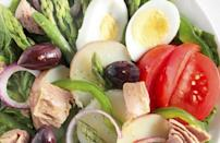 """<p>Nicoise salad, which originated in Nice, France, is traditionally made with tomatoes, hard-boiled eggs and olives. This recipe adds capers to the mix, adding a briny and salty layer to the dish.</p> <p><a href=""""https://www.thedailymeal.com/best-recipes/nicoise-salad-egglands-best?referrer=yahoo&category=beauty_food&include_utm=1&utm_medium=referral&utm_source=yahoo&utm_campaign=feed"""" rel=""""nofollow noopener"""" target=""""_blank"""" data-ylk=""""slk:For the Nicoise Salad recipe, click here."""" class=""""link rapid-noclick-resp"""">For the Nicoise Salad recipe, click here.</a></p>"""