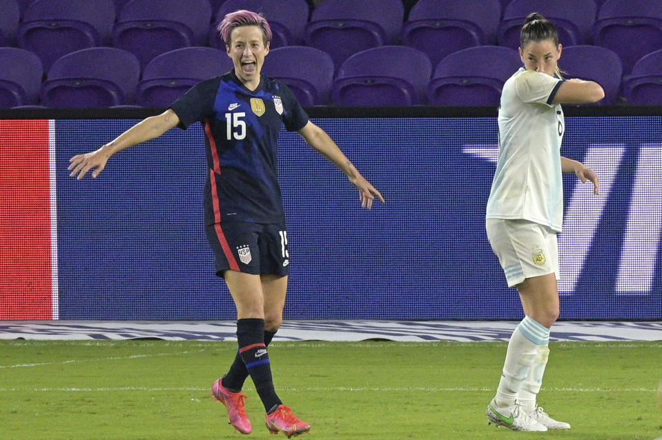 United States forward Megan Rapinoe (15) celebrates after scoring a goal in front of Argentina midfielder Vanesa Santana, right, during the first half of a SheBelieves Cup women's soccer match, Wednesday, Feb. 24, 2021, in Orlando, Fla. (AP Photo/Phelan M. Ebenhack)