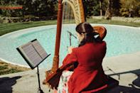 Robert's mother suggested a harpist. Melanie Genin's music created an ethereal atmosphere.