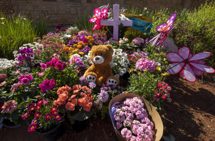 Flowers placed outside the complex where the Dickason family lived prior to their emigration to New Zealand, in Pretoria, South Africa, Thursday, Sept. 23, 2021. People in the town of Timaru are planning an evening vigil outside the home of three young girls who were killed last week in a crime that shocked New Zealand. The girls' mother Lauren Dickason has been charged with their murder. (AP Photo/Themba Hadebe)