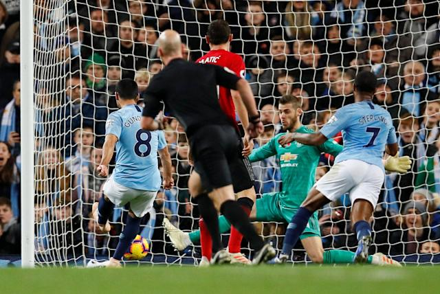 """Soccer Football - Premier League - Manchester City v Manchester United - Etihad Stadium, Manchester, Britain - November 11, 2018 Manchester City's Ilkay Gundogan scores their third goal Action Images via Reuters/Jason Cairnduff EDITORIAL USE ONLY. No use with unauthorized audio, video, data, fixture lists, club/league logos or """"live"""" services. Online in-match use limited to 75 images, no video emulation. No use in betting, games or single club/league/player publications. Please contact your account representative for further details."""