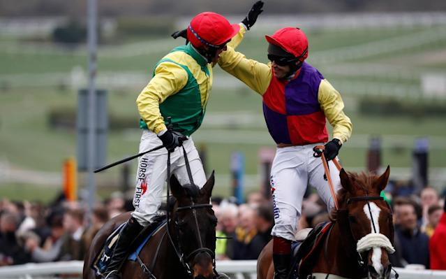 <span>Robbie Power is congratulated by Richard Johnson after winning the Cheltenham Gold Cup </span> <span>Credit: Stefan Wermuth/Reuters </span>