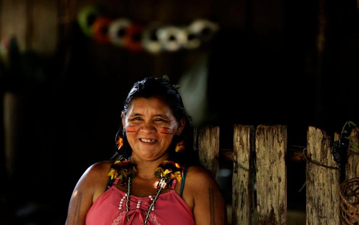 Tenetehara Indigenous Sandra Muxi Tembe smiles as she talks about the importance of the indigenous women's council formed to guide families on the pandemic - AP