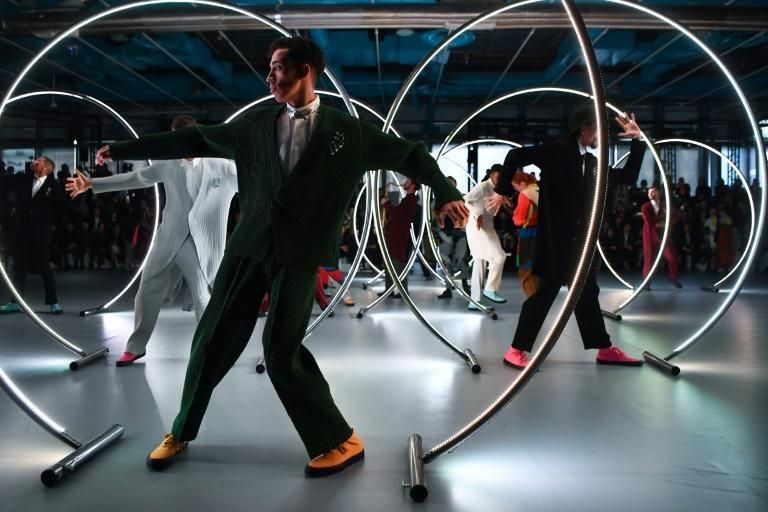 Zoot suit: Models pose between cyr wheels at the Issey Miyake men's fashion week show in Paris (AFP Photo/Anne-Christine POUJOULAT)