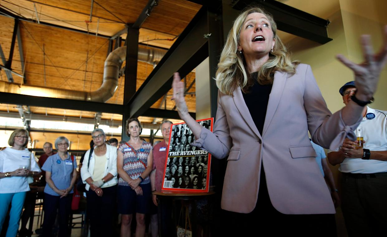 Former CIA officer and Democratic candidate for the 7th district Congressional seat, Abigail Spanberger, right, speaks to supporters at a rally in Richmond, Va., Wednesday, July 18, 2018.