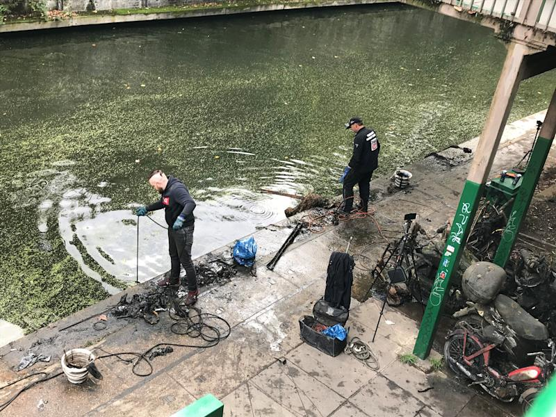 Magnet fishers Nigel Lamford and Jim Norton trawl Regent's Canal for metal objects on Sunday October 11, 2020 (Laura Parnaby/PA).