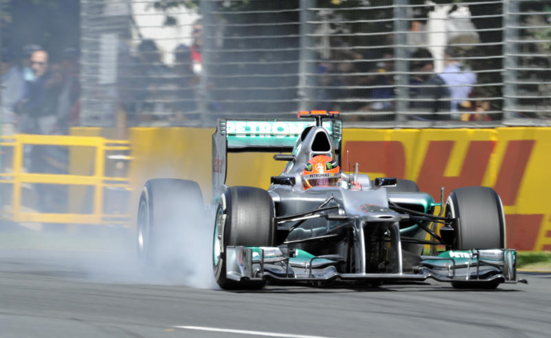 Mercedes driver Michael Schumacher of Germany locks his right front wheel on his way into turn three during the first practice session of the Australian Formula One Grand Prix at Albert Park in Melbourne, Australia, Saturday, March 17, 2012. (AP Photo/Ross Land)