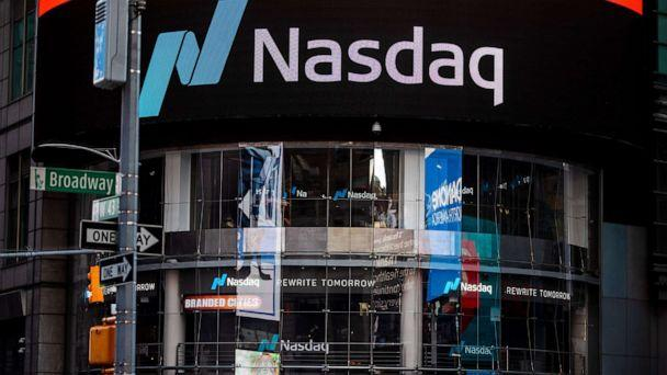 PHOTO: Signage is displayed outside the Nasdaq Market Site in the Times Square area of New York, May 12, 2020. (Demetrius Freeman/Bloomberg via Getty Images, FILE)