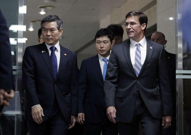 PHOTO: US Secretary of Defense Mark Esper and South Korean Defense Minister Jeong Kyeong-doo arrive for a signing ceremony ahead of a meeting at the Defense Ministry in Seoul, South Korea, August 9, 2019. (LEE JIN-MAN/POOL/EPA-EFE/REX)