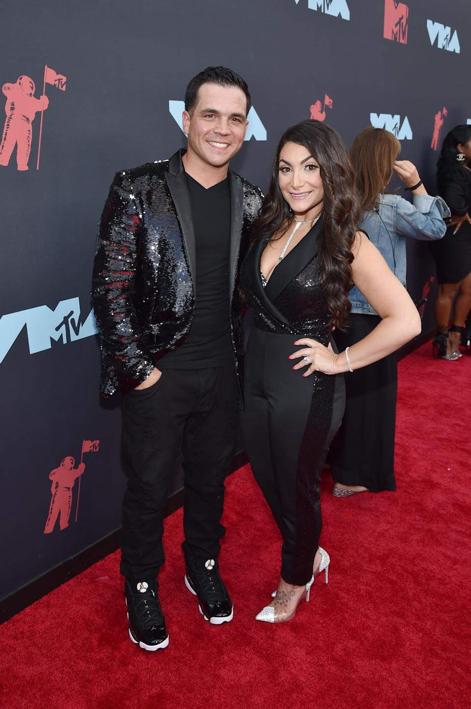 """<h1 class=""""title"""">Christopher Buckner and Deena Nicole Cortese</h1><cite class=""""credit"""">Photo: Getty Images</cite>"""