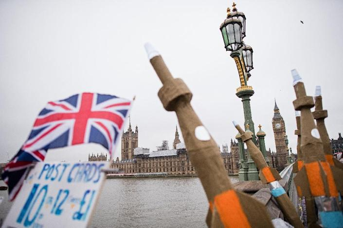 Campaigners from Amnesty International prepare to carry model missiles through Westminster in central London on March 18, 2016, to highlight the export of UK-manufactered arms to Saudi Arabia (AFP Photo/Leon Neal)