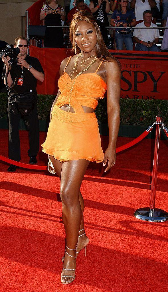 <p>We are obsessed with this cut-out, tangerine mini dress that Williams wore to the 2004 ESPY Awards.</p>