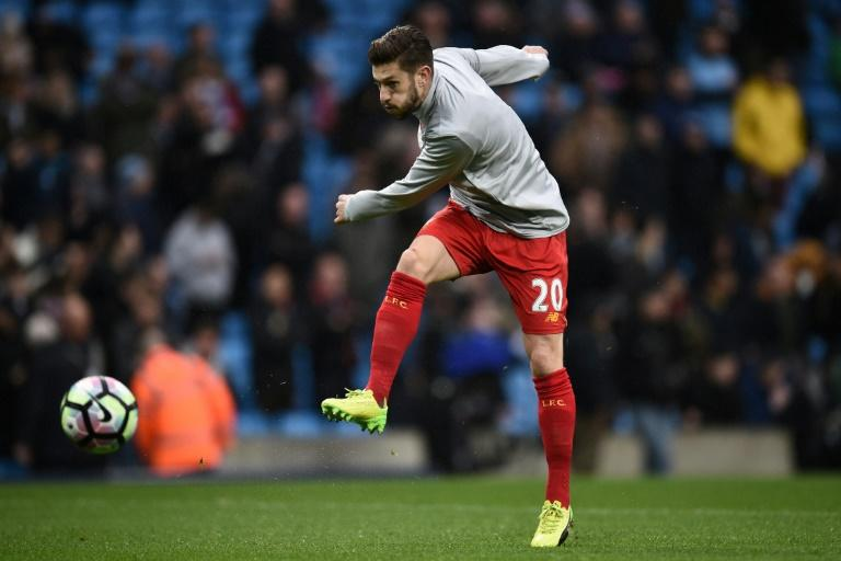 Liverpool's midfielder Adam Lallana warms up ahead of the English Premier League football match against Manchester City March 19, 2017