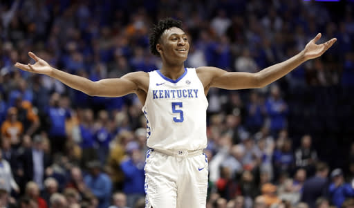 Kentucky guard Immanuel Quickley celebrates in the final seconds of an NCAA college basketball game against Alabama at the Southeastern Conference tournament Friday, March 15, 2019, in Nashville, Tenn. Kentucky won 73-55. (AP Photo/Mark Humphrey)
