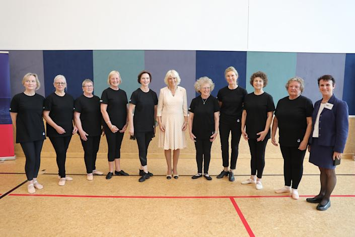 """CHRISTCHURCH, NEW ZEALAND - NOVEMBER 22:  Camilla, Duchess of Cornwall poses with the """"Silver Swans"""" dancers as she attends an Active Elderly engagement at the Salvation Army Centre on November 22, 2019 in Christchurch, New Zealand. The Prince of Wales and Duchess of Cornwall are on an 8-day tour of New Zealand. It is their third joint visit to New Zealand and first in four years. (Photo by Chris Jackson/Getty Images)"""