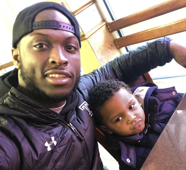 In this Feb. 10, 2018 photo, former Temple running back David Hood takes a selfie with his son, David IV in Mays Landing, N.J. Hood, who was Temples leading rusher last season, was one of four Owls players parenting young children in 2017. Hood, 21, has moved on from football, graduating from Temple and leaving a year of football eligibility behind after sustaining a concussion this past spring. He has decided to focus solely on a promising career as a rapper. (David Hood via AP)
