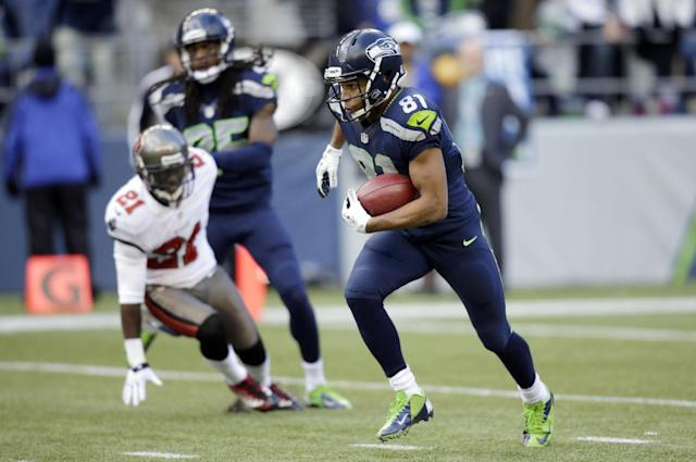 Seattle Seahawks' Golden Tate returns a punt for a 71-yard run in the second half of an NFL football game against the Tampa Bay Buccaneers, Sunday, Nov. 3, 2013, in Seattle. (AP Photo/Stephen Brashear)