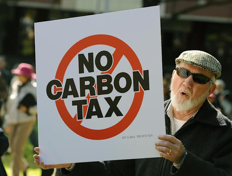 A protester holds a placard during a no carbon tax rally in Sydney on July 1, 2012 (AFP Photo/Greg Wood)