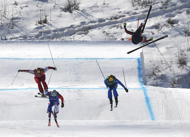 <p>Christopher Del Bosco of Canada, right, flies through the air as Sergey Ridzik, Olympic Athletes of Russia, left to right, Francois Place of France and Siegmar Klotz of Italy compete in the men's ski cross elimination round at the 2018 Winter Olympic Games in Pyeongchang, South Korea, Wednesday, Feb. 21, 2018. THE CANADIAN PRESS/Jonathan Hayward </p>