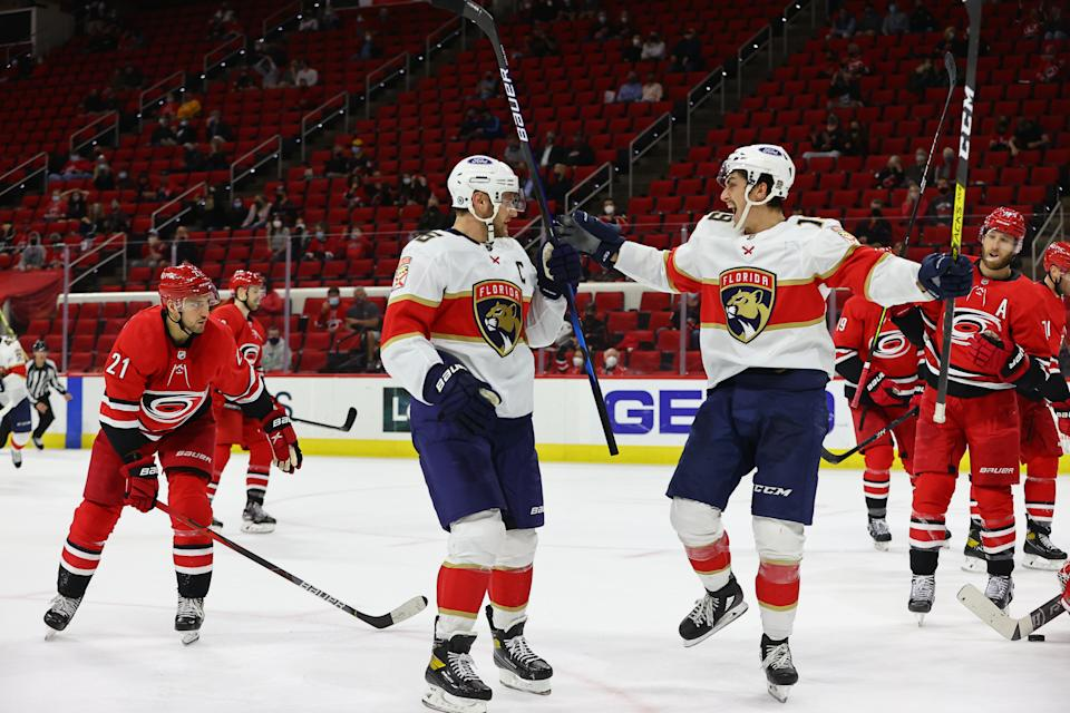 RALEIGH, NC - APRIL 06: Florida Panthers center Aleksander Barkov (16) and Florida Panthers left wing Mason Marchment (19) celebrate a goal during the 2nd period of the Carolina Hurricanes vs Florida Panthers on April 6th, 2021 at PNC Arena in Raleigh, NC (Photo by Jaylynn Nash/Icon Sportswire via Getty Images)