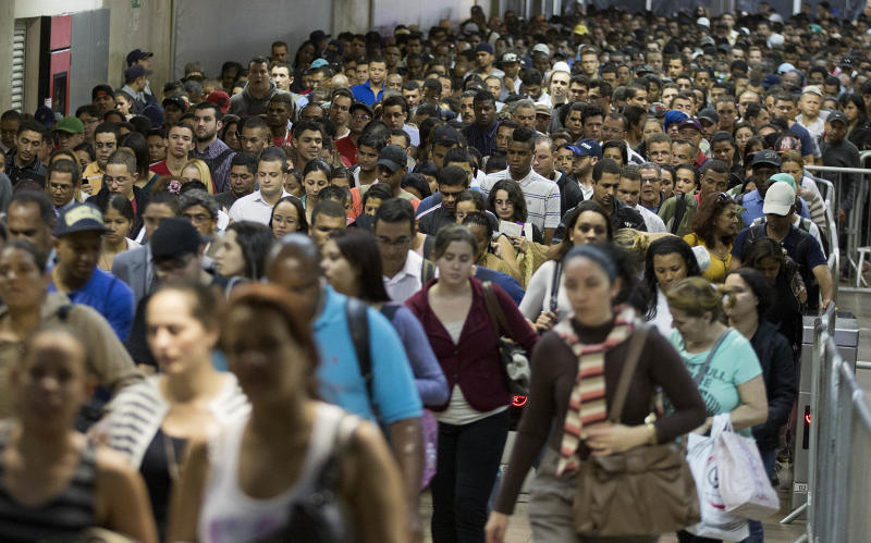 In this Aug. 12, 2013 photo, passengers pack a subway station in Sao Paulo, Brazil. Exhausted workers often travel two or three hours each way, crammed into tightly packed buses and subways. Such experiences helped spark the biggest revolts to hit Brazilian streets in a generation. (AP Photo/Andre Penner)