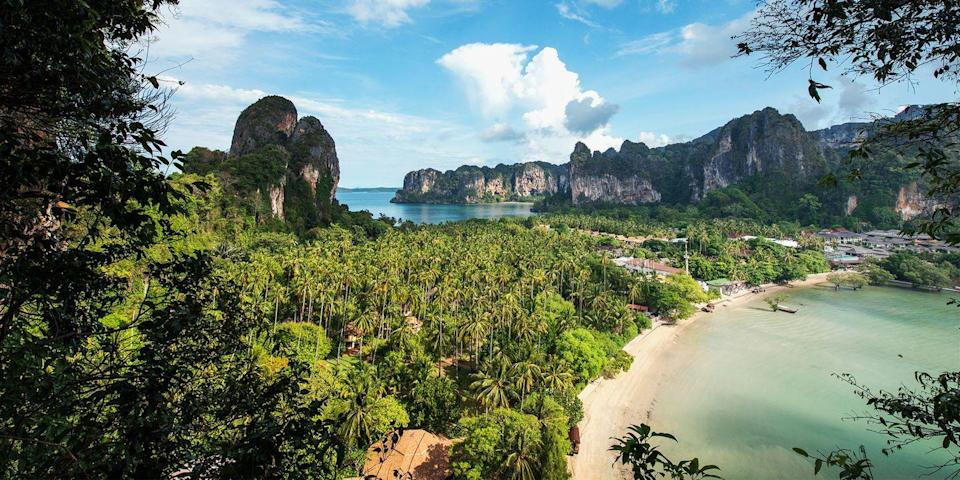 """<p>The Krabi province of Thailand is known as having some of the <a href=""""https://www.bestproducts.com/fun-things-to-do/g22521963/beautiful-beaches-in-thailand/"""" rel=""""nofollow noopener"""" target=""""_blank"""" data-ylk=""""slk:most beautiful beaches"""" class=""""link rapid-noclick-resp"""">most beautiful beaches</a> in the world. One of the most photographed — and with good reason — is Railay Beach, a pure white-sand beauty framed by towering limestone cliffs. Another Krabi stunner is <a href=""""https://www.tripadvisor.com/Attraction_Review-g1507054-d1426253-Reviews-PhraNang_Cave_Beach-Ao_Nang_Krabi_Town_Krabi_Province.html"""" rel=""""nofollow noopener"""" target=""""_blank"""" data-ylk=""""slk:Phra Nang"""" class=""""link rapid-noclick-resp"""">Phra Nang</a>, which is also surrounded by rock formations and reached via a 10-minute walk through a cave.</p>"""