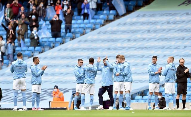 Sergio Aguero gets a guard of honour before the game