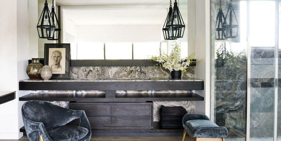 """<p><a href=""""https://www.elledecor.com/celebrity-style/celebrity-homes/g1366/courteney-coxs-private-retreat/"""" target=""""_blank"""">Courteney Cox's California home</a> features a sophisticated bathroom design, including a double vanity with ebonized white oak cabinets. </p>"""