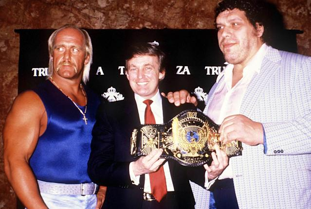 Wrestlers Hulk Hogan (L) and Andre the Giant (R) pose in the 1980s with future U.S. President Donald Trump. (Russell Turiak/Getty Images)