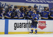 St. Louis Blues' Jaden Schwartz (17) celebrates with Ryan O'Reilly (90) and other teammates after scoring a goal in the first period of an NHL hockey game against the Minnesota Wild, Wednesday, May 12, 2021 in St. Louis. (AP Photo/Tom Gannam)